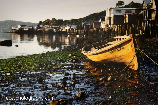 chile boat travel chiloe castro fishing palafitos stilt houses ocean sea mud south america