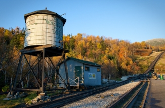 mount washington cog railway water tower train fall leaves color yellow red orange tracks historic travel